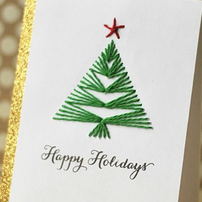 красивая открытка с вышитой елкой
